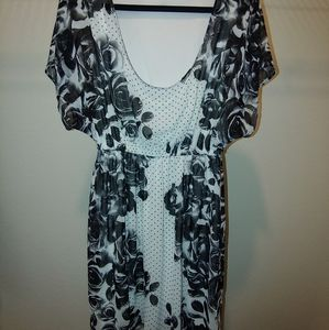 White dress with black flowers and gold polka dots